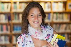 Close up of a smiling female student in the library. Close up portrait of a smiling female student in the library Stock Image