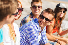 Close up of smiling friends sitting on city street Stock Photos