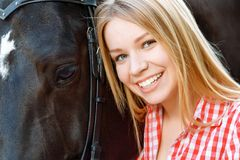 Close up of smiling girl with the horse Stock Images