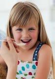 Close-up of smiling girl taking medicine Royalty Free Stock Photos