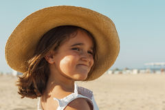 Close up smiling girl wearing wicker hat in summer. Beach background. royalty free stock photography