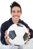 Close up of a smiling handsome football fan Royalty Free Stock Images
