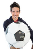 Close up of a smiling handsome football fan Stock Image