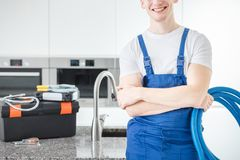 Close-up of smiling handyman stock image