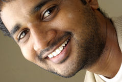 Close up of smiling Indian young man Stock Photos
