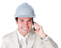 Close-up of a smiling male architect on phone Stock Images