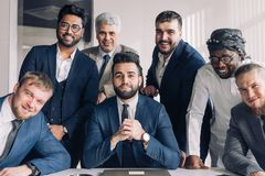 Multiracial group of business team consisting of men only with Executive indoor royalty free stock photos