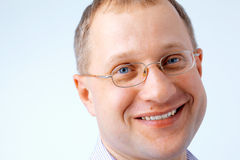 Close up of a Smiling Man. Close up portrait of a smiling man wearing glasses Royalty Free Stock Image