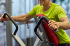Close up of smiling man exercising on gym machine Royalty Free Stock Image