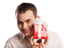 Close-up  smiling man holding gift isolated Royalty Free Stock Image