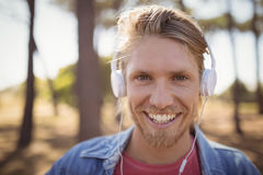 Close up of smiling man listening music on headphone Royalty Free Stock Photography