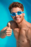 Close-up of smiling man in watersport goggles Stock Image