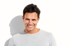 Close up smiling older handsome man against white background Royalty Free Stock Photo