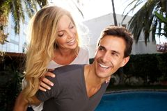 Close up smiling pair in love outside in embrace. Close up portrait of smiling pair in love outside in embrace Royalty Free Stock Images