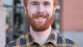 Close up of  Smiling Redhead Beard Young Man, Outdoor stock video