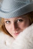 Close-up of smiling redhead in blue hat Stock Photography