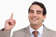 Close up of smiling salesman pointing up Royalty Free Stock Photography