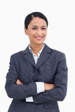 Close up of smiling saleswoman with arms folded Royalty Free Stock Images