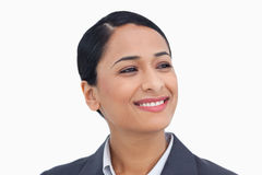 Close up of smiling saleswoman looking to the side. Against a white background Royalty Free Stock Photos