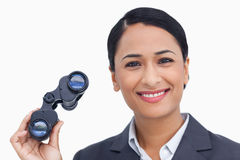 Close up of smiling saleswoman with spy glasses Royalty Free Stock Image