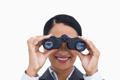 Close up of smiling saleswoman using spy glasses Stock Photography