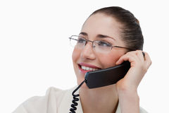 Close up of a smiling secretary making a phone call Royalty Free Stock Images