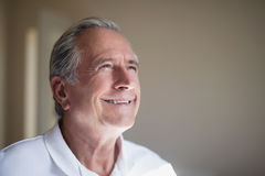 Close-up of smiling senior male patient looking away Stock Images