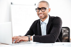 Close-up of smiling smart businessman working with computer Stock Photos