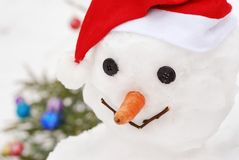 Close-up smiling snowman with  christmas tree Royalty Free Stock Images