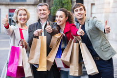 Close up of smiling tourists with purchases Royalty Free Stock Photography