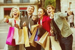 Close up of smiling tourists with purchases Royalty Free Stock Images