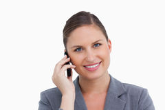 Close up of smiling tradeswoman on her cellphone Royalty Free Stock Photos