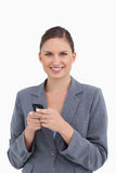 Close up of smiling tradeswoman holding cellphone Royalty Free Stock Image