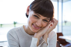 Close-up of smiling woman in cafeteria Royalty Free Stock Images