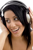 Close up of smiling woman holding headphone Stock Image