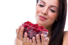 Close up of smiling woman holding raspberries Royalty Free Stock Photos
