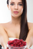 Close up of smiling woman holding raspberries Royalty Free Stock Images