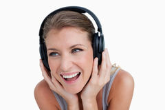 Close up of a smiling woman listening to music Royalty Free Stock Photos