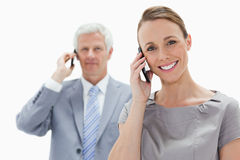 Close-up of a smiling woman making a call with a white hair man Royalty Free Stock Photos