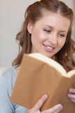Close up of smiling woman reading a book Royalty Free Stock Photo