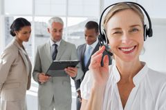 Close up of smiling woman standing with a headset Royalty Free Stock Photography
