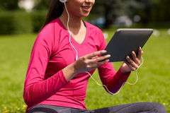 Close up of smiling woman with tablet pc outdoors Stock Photos