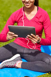 Close up of smiling woman with tablet pc outdoors Stock Images