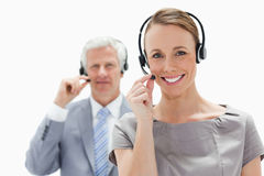 Close-up of a smiling woman wearing a headset Royalty Free Stock Image