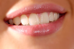 Close up of smiling womans mouth and teeth Stock Photos