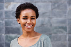 Close up smiling young black female fashion model stock photo