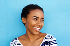 Close up smiling young black woman looking away Royalty Free Stock Photography