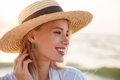 Close up of a smiling young girl in summer hat. At the beach looking away Royalty Free Stock Images