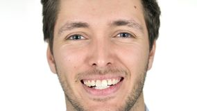 Close Up of Smiling Young Man Face, White Background stock footage