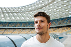 Close up of a smiling young man standing at the stadium Royalty Free Stock Photos